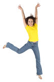 Woman in yellow shirt and jeans jumping Royalty Free Stock Photography