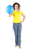 Woman in yellow shirt and jeans offers balloon Stock Photo
