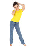 Woman in yellow shirt and jeans standing Royalty Free Stock Photo