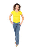 Woman in yellow shirt and jeans standing Stock Image
