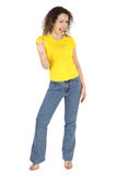 Woman in yellow shirt and jeans, thumbs up Stock Images