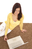 Woman yellow shirt laptop from above Stock Image