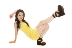Woman yellow short dress down leg up Royalty Free Stock Images