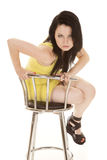 Woman yellow short dress sit lean forward stock images
