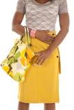 Woman yellow skirt bag body Royalty Free Stock Image