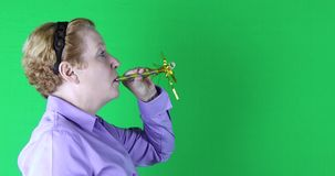 Woman with yellow streamer, left side, green screen, 4K stock video