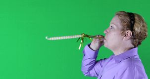 Woman with yellow streamer, right side, green screen, 4K stock footage