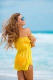 A woman in a yellow sundress on a tropical beach Stock Photos