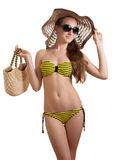 Woman in yellow swimsuit. Glamorous woman in a yellow bikini isolated on white Stock Images
