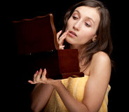 Woman in yellow towel keeping wooden box Stock Photography