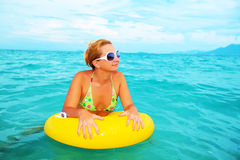 Woman with yellow tube Stock Image