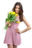 Woman with yellow tulips bouquet Stock Photos