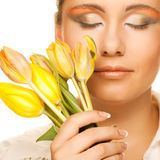 woman with yellow tulips  over white Royalty Free Stock Photos
