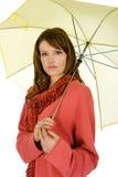 Woman with yellow umbrella Stock Photos