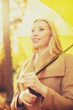 Woman with yellow umbrella in the autumn park Stock Image