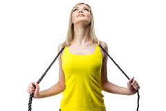 Woman in yellow with whip Royalty Free Stock Photo