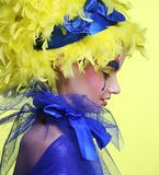 Woman with yellow wig feather Stock Images
