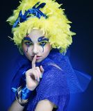 Woman with yellow wig feather Stock Photo