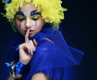 Woman with yellow wig feather Royalty Free Stock Photos