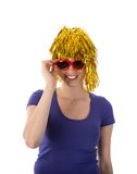 Woman with yellow wig and red sunglasses Stock Image