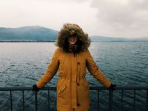 Woman in Yellow Winter Jacket stock image