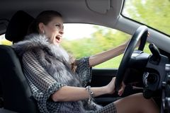 Woman yells in car Royalty Free Stock Photo