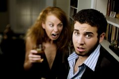 Woman Yells at Man. Young woman with cocktail yells at a man at party Stock Images