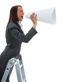 woman yells in megaphone Royalty Free Stock Photos