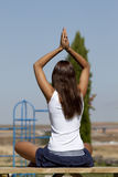 Woman yoga. Young woman relaxing making yoga in a park Royalty Free Stock Image