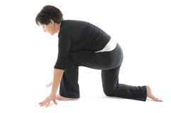Woman  yoga  Anjaneyasana Kneeli Stock Photos