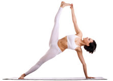 Woman in yoga asana - Side Plank pose Stock Image