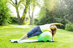 Woman on yoga balance ball Royalty Free Stock Images