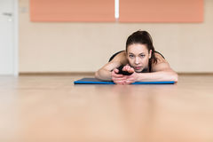 Woman yoga, Bhekasana, Frog Pose in gym Stock Images