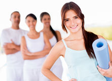 Woman in a yoga class Royalty Free Stock Image