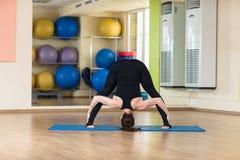 Woman yoga Dvikonasana Double, Triangle Pose Stock Image