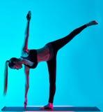 Woman yoga exercices Ardha Chandrasana half moon Royalty Free Stock Images