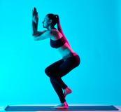 Woman yoga exercices Garudasana eagle pose Stock Photos