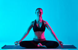 Woman yoga exercices Padmasana Lotus position Stock Photos