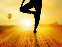 Woman yoga exercise in sunrise, soft and blur concept Stock Photo