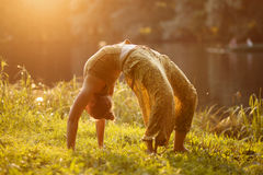 Woman Yoga exercises outdoor Royalty Free Stock Image