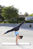 Woman in a yoga handstand with legs split Royalty Free Stock Photos