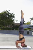 Woman in a yoga headstand Stock Photo