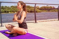 Woman in yoga lotus position - relax. Woman in yoga lotus position - relax smiling Royalty Free Stock Photos