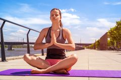 Woman in yoga lotus position - relax. Woman in yoga lotus position - relax  smiling Stock Photos