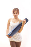 Woman with yoga mat Stock Photography