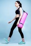 Woman with yoga mat Stock Photos