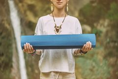 Woman with yoga mat outdoor. royalty free stock image