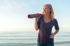 Woman with yoga mat Royalty Free Stock Photo
