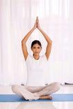 Woman yoga meditating. Peaceful indian woman yoga meditating at home Stock Photo