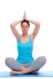 Woman in a yoga meditation pose Royalty Free Stock Photos